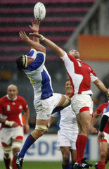 Georgia's Giorgi Chkhaidze fights for the ball with Namibia's Marius Visser during the Group D Rugby World Cup match at the Felix Bollaert Stadium in Lens
