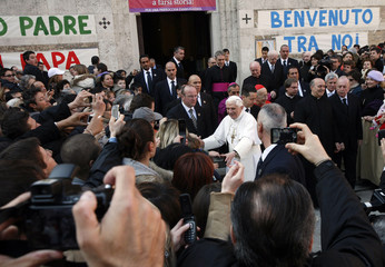 Pope Benedict XVI is greeted by faithful as he leaves after celebrating mass at Santa Maria Liberatrice church in Rome