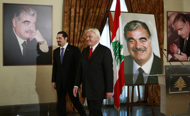 Lebanon's Prime Minister-designate al-Hariri and German Foreign Minister Steinmeier leave after delivering a joint news conference at Hariri's residence in Beirut