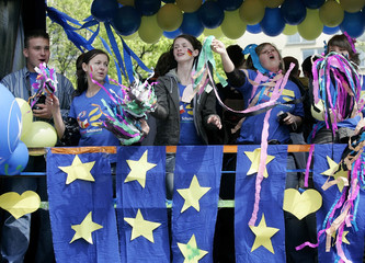 Youths take part in an European Union parade in central Warsaw