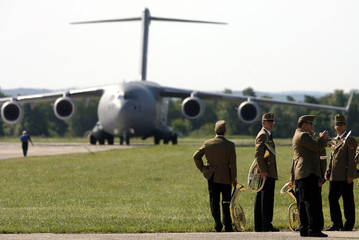 A military band waits for the arrival of the first C-17 transport aircraft belonging to NATO's Strategic Airlift Capability (SAC) at Papa Air Base in Papa