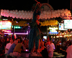 Thai transvestite dances to attract customers at a go-go bar in Patong Beach on the Thai resort ...