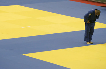 Japan's Suzuki bows after losing his match against Lithuania's Zilinskas in the men's -100kg category at the World Judo Championships in Rio de Janeiro