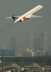 A SAS MD-82 takes off from Frankfurt airport