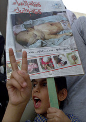 A SEVEN-YEAR-OLD JORDANIAN GIRL DEMONSTRATES IN AMMAN WITH PICTURE OF SLAIN PALESTINIAN BABY.