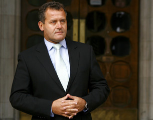 Princess Diana's former butler Paul Burrell poses for photographers at the High Court in London