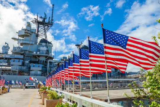 American flags in line at Missouri Warship Memorial in Pearl Harbor Honolulu Hawaii, Oahu island of United States. National historic patriotic landmark.