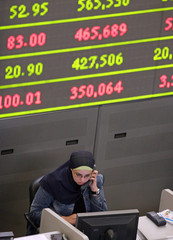 An Egyptian broker works at the Cairo Alexandria Stock Exchange in downtown Cairo