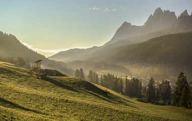 Alpine meadow at sunset, Dolomites, Italy Wall mural