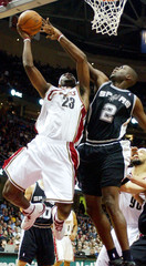 Spurs Mohammed attempts to block shot by Cavaliers James in Cleveland