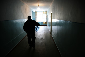 Ukrainian man carries his x-ray image in a hospital in Ivankov