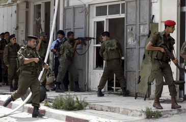 Members of the Palestinian security forces take position in Qalqilya