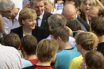 German Chancellor Merkel walks through the crowd in the garden of the chancellery during the open house in Berlin