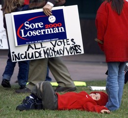 BOY PLAYS UNDER PROTESTORS IN TALLAHASSEE FLORIDA.