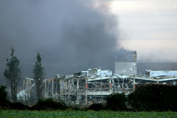A building is destroyed after an explosion next to a fuel depot in Hemel Hempstead in central England
