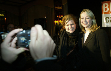 CONSERVATIVE CANDIDATE STRONACH IS PHOTOGRAPHED BY A SUPPORTER DURING A MONTREAL RECEPTION.