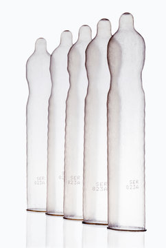 Inflated condoms standing in row