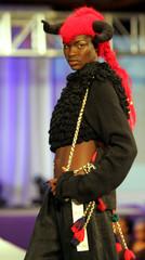 Kenyan model Nancy Ajuma Nasenyana presents a creation of Bosnian fashion designer Jasma Hadzimehmed..