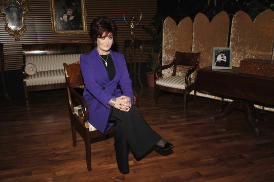 Sharon Osbourne poses for photographers during a photo-call to promote the Osbourne Auction in London