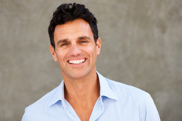 Close up handsome casual businessman smiling Wall mural
