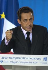 France's President Sarkozy delivers a speech after a visit at the liver transplant section of Villejuif Paul-Brousse hospital