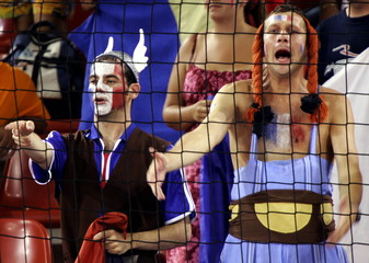 French fans dressed as French cartoon caracters 'Asterix' and 'Obelix' cheer during the women's hand..
