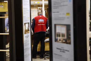A Lowe's store employee works in Garden City