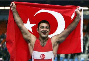 Yerlikaya of Turkey celebrates after winning gold medal in greco roman wrestling 96kg in European Wrestling Championships in Moscow
