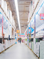 Blurred aisle with finishing materials in hardware store
