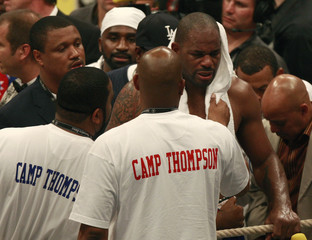 U.S. contender Thompson is comforted by members of his team in Hamburg