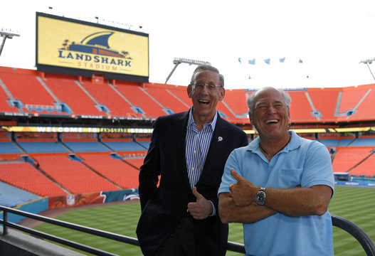 Owner and managing general partner of The Miami Dolphins football team Ross and singer Buffett pose for a picture during the renaming event of the Dolphins stadium in Miami