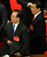CHINESE PREMIER WEN JIABAO HOLDS HIS BAG BESIDE PRESIDENT HU JINTAO TO LEAVE AFTER THE SECOND DAY ...