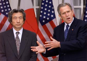 U.S. President George W. Bush speaks to the press with Japanese Prime Minister Junichiro Koizumi fol..
