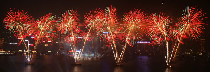 Fireworks explode over Hong Kong's Victoria Harbour during the opening ceremony of the East Asian Games