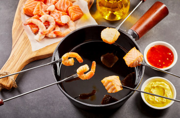 Healthy seafood fondue with dipping sauces