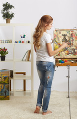 Painter female with wooden sketchbook and painting