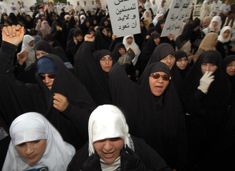 KUWAITIES MARCH IN ANTI-U.S. AND ISRAELI PROTEST IN KUWAIT.