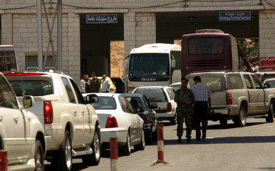 Tourist cars carrying Arabs flee Beirut through country's eastern border post with Syria