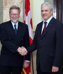 Serbian President Tadic shakes hands with Danish Foreign Minister Moeller during a meeting in ...