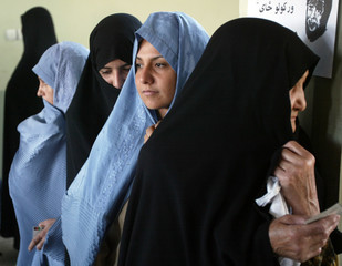 Afghan women wait in line to vote in the parliamentary elections in Herat.
