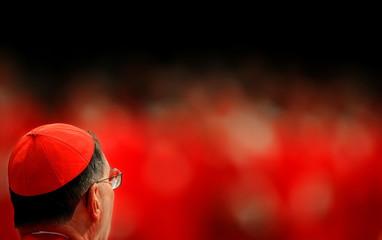 U.S. Cardinal Roger Michael Mahony attends a mass led by bishop Leonardo Sandri of Argentina in Sain..