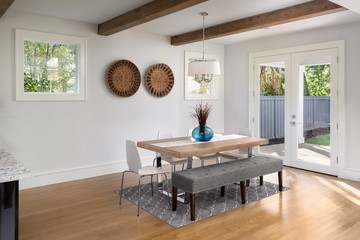 Elegant Dining Room in New Luxury Home with French Doors Leading to Patio and Landscaped Backyard