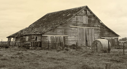 Old Barn with Hay Bales in Sepia