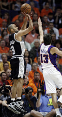 San Antonio Spurs Tony Parker shoots over Phoenix Suns Steve Nash in NBA basketball action from Phoenix