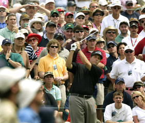 PHIL MICKELSON TEES OFF DURING MASTERS FOURTH ROUND.