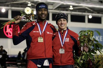 Davis and teammate Marsicano of the U.S. pose with Gold and Silver medals from the Men's 1500m Essent ISU World Cup Speedskating finals in Utah