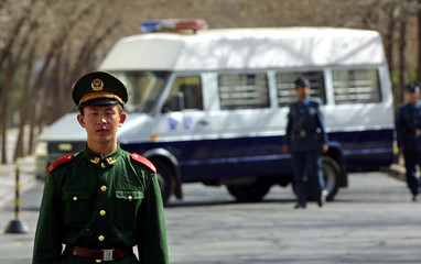 A CHINESE SOLDIER STANDS GUARD OUTSIDE THE SPANISH EMBASSY IN BEIJING25 NORTH KOREAN REFUGEES ...