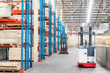 Forklift  in Warehouse storage of retail merchandise shop.