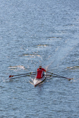 Two older men in a Sculling boat