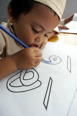-PHOTO TAAKEN 13FEB06- An Indonesian Muslim boy practises colouring Arabic letters during a morning ..